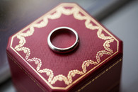 cartier wedding band on red box