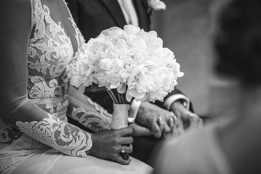 Bride holding bouquet during church service