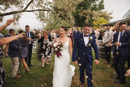 petal throwing as bride and groom exit ceremony country wedding de lumiere photography