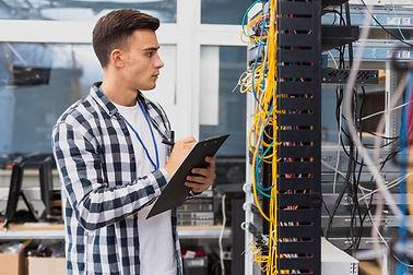 electrical-engineer-looking-network-swit