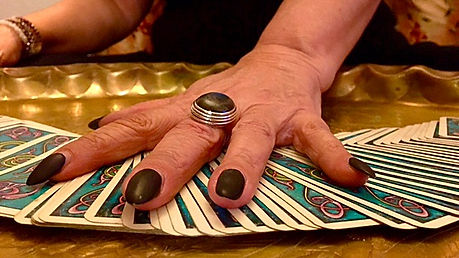 Hand of The Orgasmic Witch as she is shuffling the tarot deck.