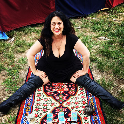The Orgasmic Witch reading cards upon her magic carpet at the site of Southern California's Renn Faire.