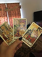 Hand of the Orgasmic Witch holding a 3 card reading.