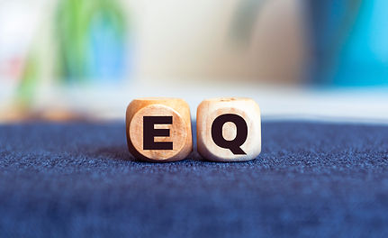 Wooden cubes and blocks with words 'EQ - emotional quotient'. Psychological concept. Copy