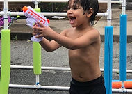 Kid with water gun.jpg