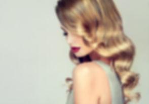 Beautiful girl with long wavy hair .jpg