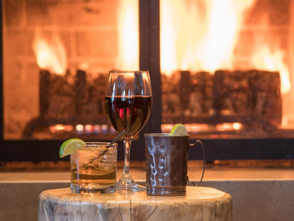 Wine and cocktails at the Knob Hill Inn Bar fireplace