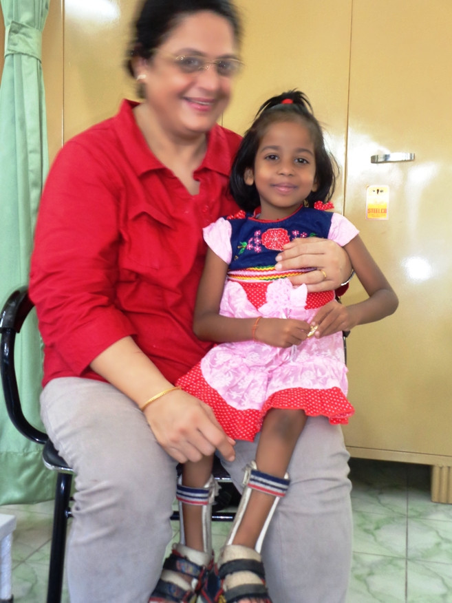 Anushka sitting on UDAAN Administrator, Mrs. Sarita Dhir's lap
