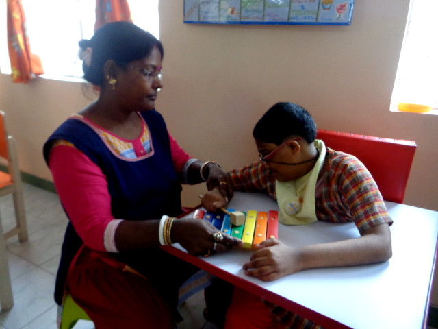 Basanti attending to special child Riya (Cerebral Palsy)