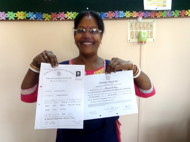 Basanti Roy with her certificates