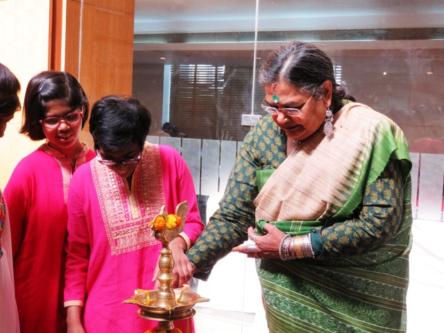 Usha Uthup Lights the Diya with one of our Special Children