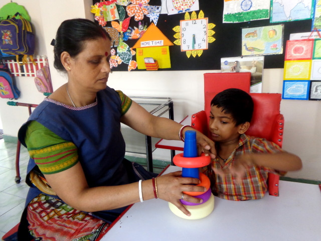 Deepa attending to Special child Aryan Shaw (Cerebral Palsy)