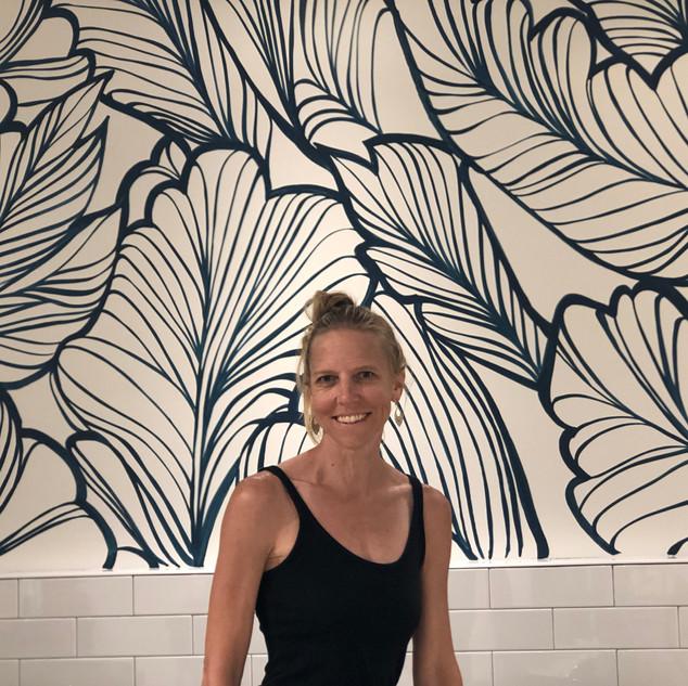 Megan Jefferson Artist with mural