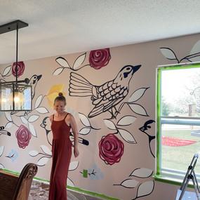 Artist Megan Jefferson with mural