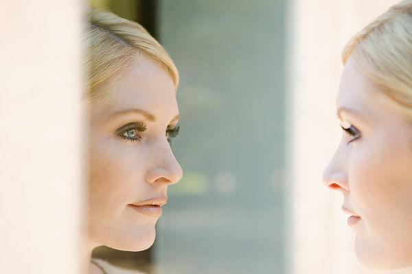 Woman looking in mirror.jpg