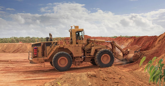 a huge bulldozer at Weipa bauxite mine.j