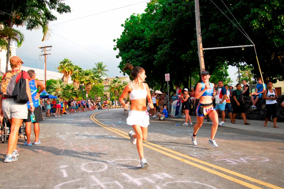 Mikaela and Cait running down Ail'i Drive