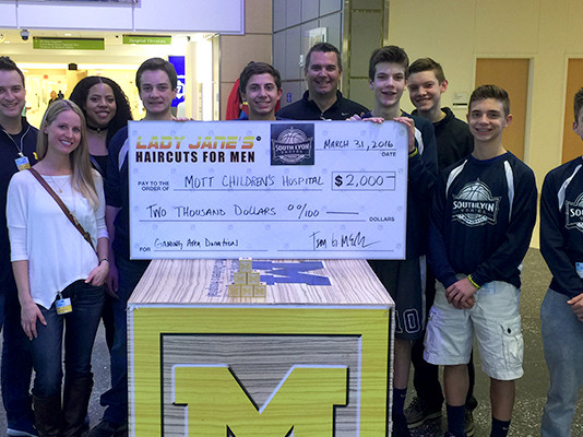 Lady Jane's & South Lyon Basketball Raises $2,000 for C.S. Mott Children's Hospital