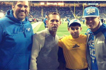 Brendan with a Surprise Visit to Ford Field After Surgery