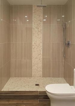 verticle pebble tile shower