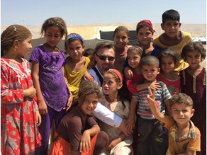 Thousands of refugee children walked barefoot in temperatures up to 50 degrees Celsius, while Kurdis