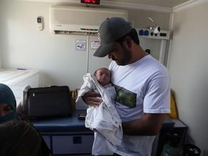 Malnourished Infant Receives Milk Powder