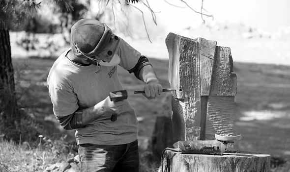 Adi works on basalt stone - BW.jpg