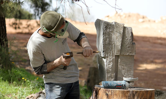 Adi works on basalt stone 2.jpg