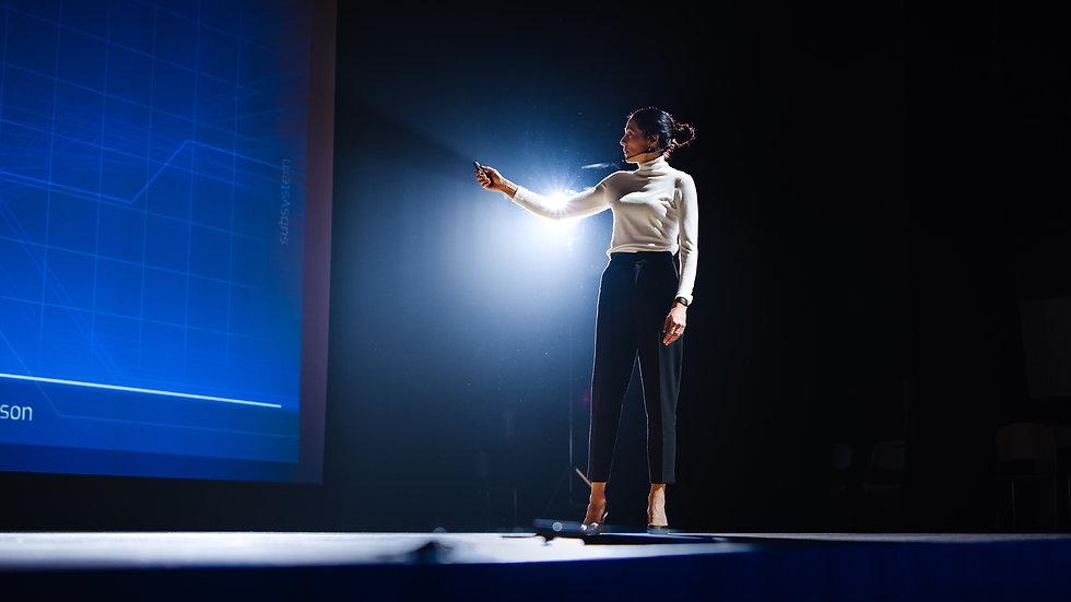 female speaker at event modern.jpeg