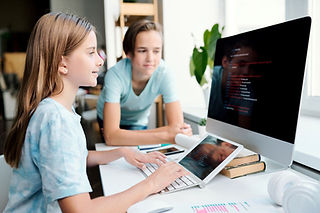pretty-youthful-girl-typing-on-computer-