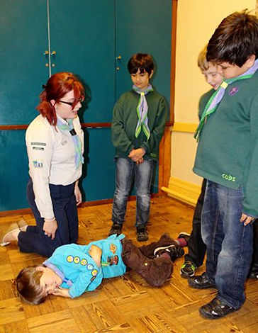 Triniy Sutton scouts learning First Aid