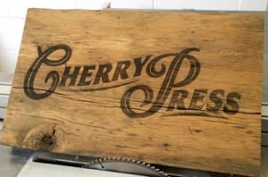 cherry press laser etch.jpg
