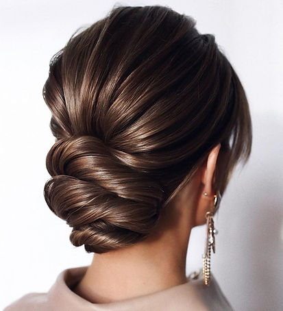 1-low-bun-updo-for-long-hair-B6BBj3qAMTn