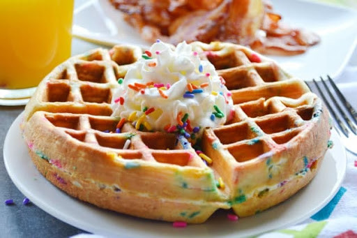 Confetti Waffle with whipped topping and sprinkles