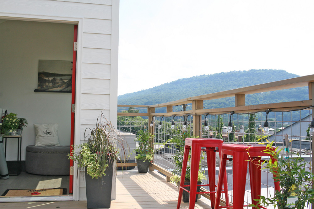 Rooftop view of Lookout mountain with red stools, lights, and plants
