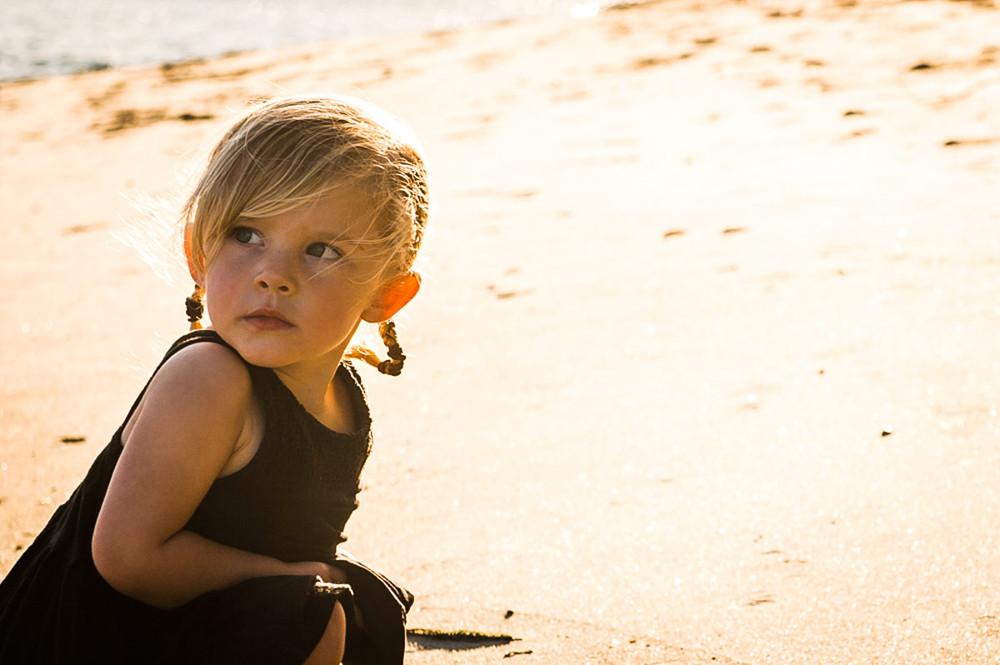 girl in golden light on beach