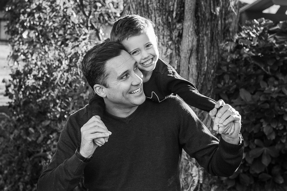 balck and white image dad and son have hug