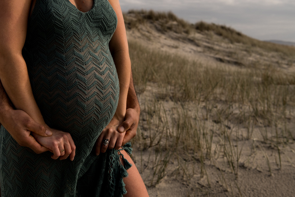 Hands and the bump Maternity beach shoot in Mangawhai by Josie Gritten Photography
