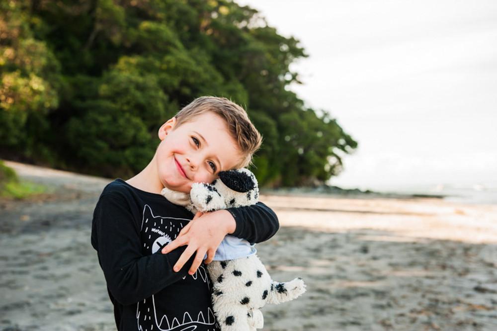 little boy hugging teddy