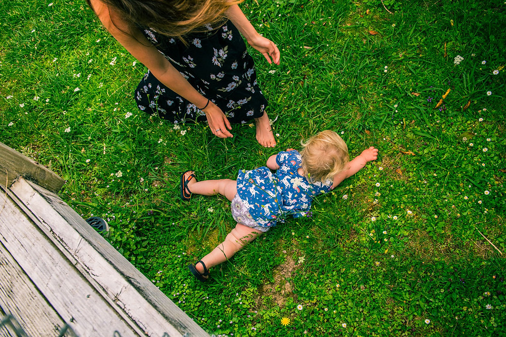 uh oh the baby fell off the deckBlack & white image of mum looking lovingly at daughter by documentary family photographer Josie Gritten