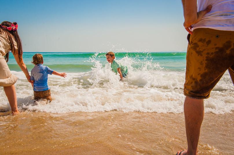 mum-dad-kids-on-beach-josie-gritten.jpg