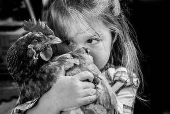 Girl and chicken Josie Gritten.jpg