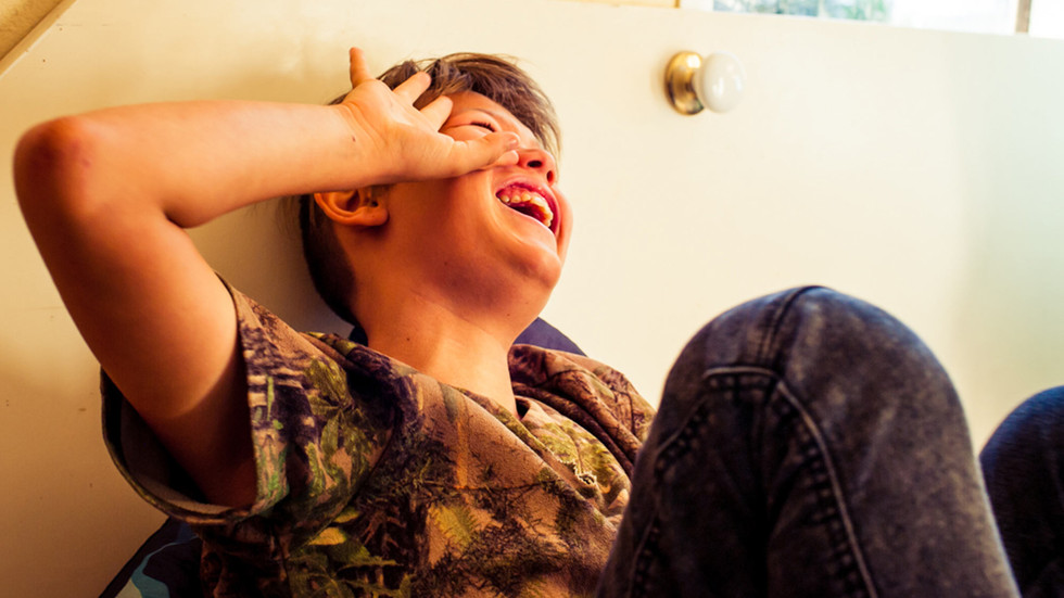 boy-with-head-back-laughing-josie-gritte