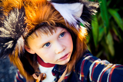 autumnal boy in a fox ha