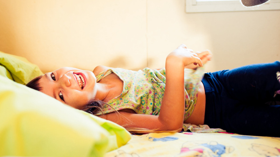 girl-lies-on-bed-smiling-josie-gritten-p