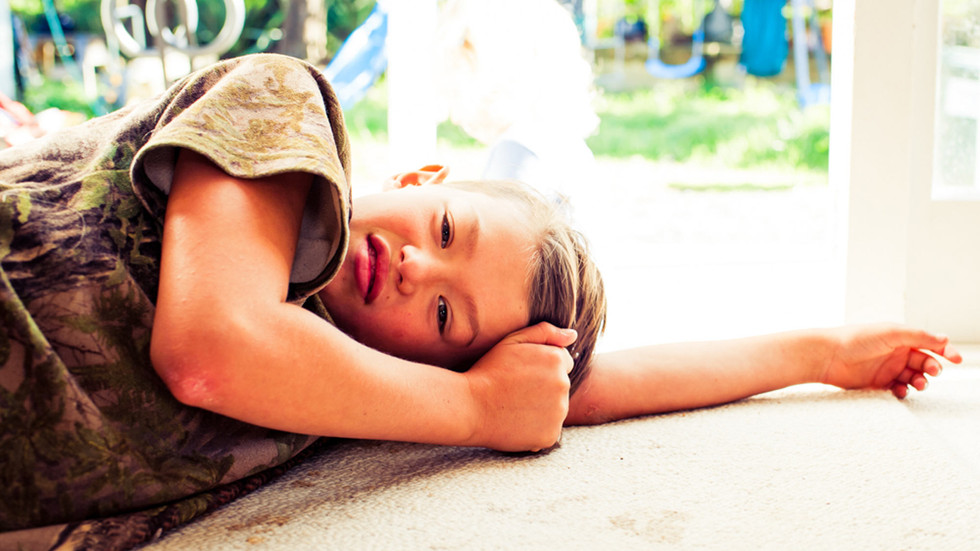 boy-lies-on-floor-josie-gritten-photogra