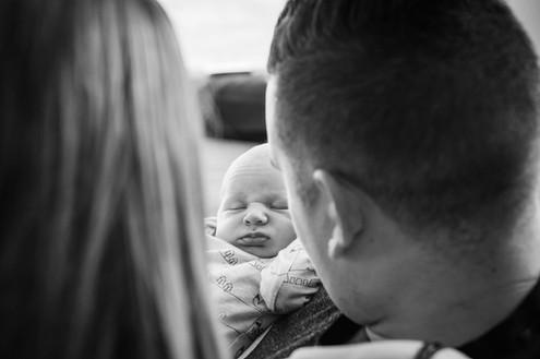 mum-dad-look-at-baby-josie-gritten.jpg