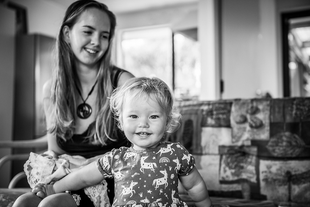 Black & white image of mum looking lovingly at daughter by documentary family photographer Josie Gritten