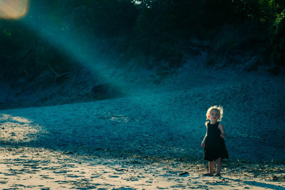 little girl in a beam of light