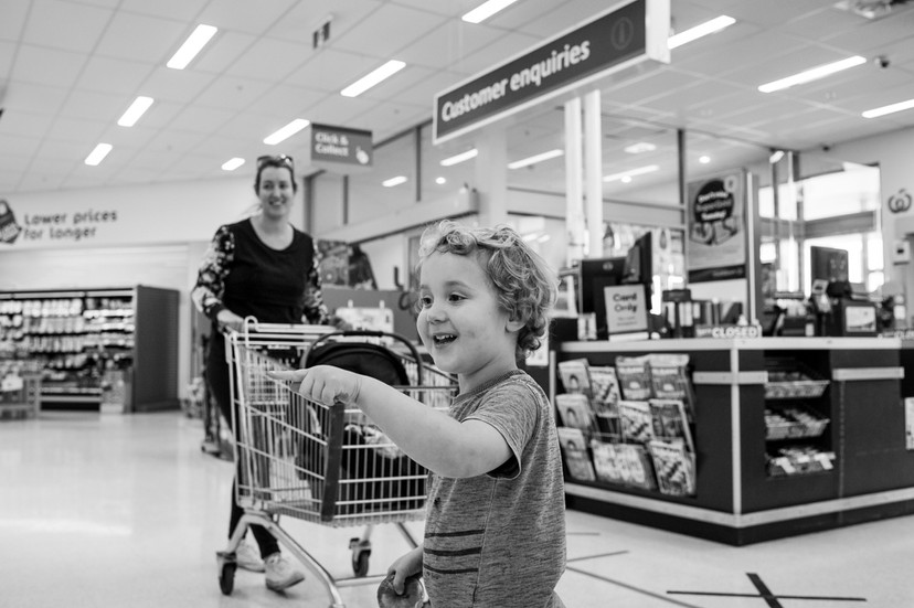 Toddler pointing in shop